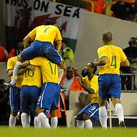 Photo: Ed Godden.<br /> Brazil v Wales. International Friendly. 05/09/2006.<br /> Brazil players jump on Marcelo, the scorer of the first goal.