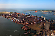 Nederland, Zuid-Holland, Europoort,  23-05-2011; Ertsoverslagbedrijf Europoort C.V. (EECV) aan de Dintelhaven, met op het tweede plan Calankanaal en de Nieuwe Waterweg. .Ore Transfer Company Europoort C.V. (EECV) at  Dintelhaven (Dintel harbour) in the Port of Rotterdam, Calandkanaal and Nieuwe Waterweg  (channels)  in the back..luchtfoto (toeslag), aerial photo (additional fee required).copyright foto/photo Siebe Swart