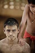 Portraits of young Kushti wrestlers taking a break from his practice, Varanasi, India