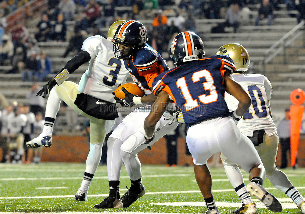 Charles Henderson's Joshua Noel (21) catches a touchdown pass over Dora players during the first half of a football game in the third round of the AHSAA playoffs in Troy, Ala., Friday, Nov. 23, 2012. (Photo/Thomas Graning)