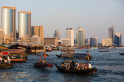 Dubai Creek. Abras (water taxis) in front of the skyline.