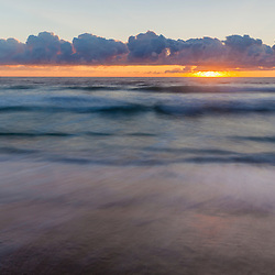 Dawn over the Atlantic Ocean at Coast Guard Beach in the Cape Cod National Seashore in Eastham, Massachusetts.