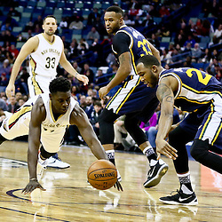Feb 10, 2016; New Orleans, LA, USA; New Orleans Pelicans guard Jrue Holiday (11) and Utah Jazz forward Chris Johnson (23) scramble for a loose ball during the first quarter of a game at the Smoothie King Center. Mandatory Credit: Derick E. Hingle-USA TODAY Sports