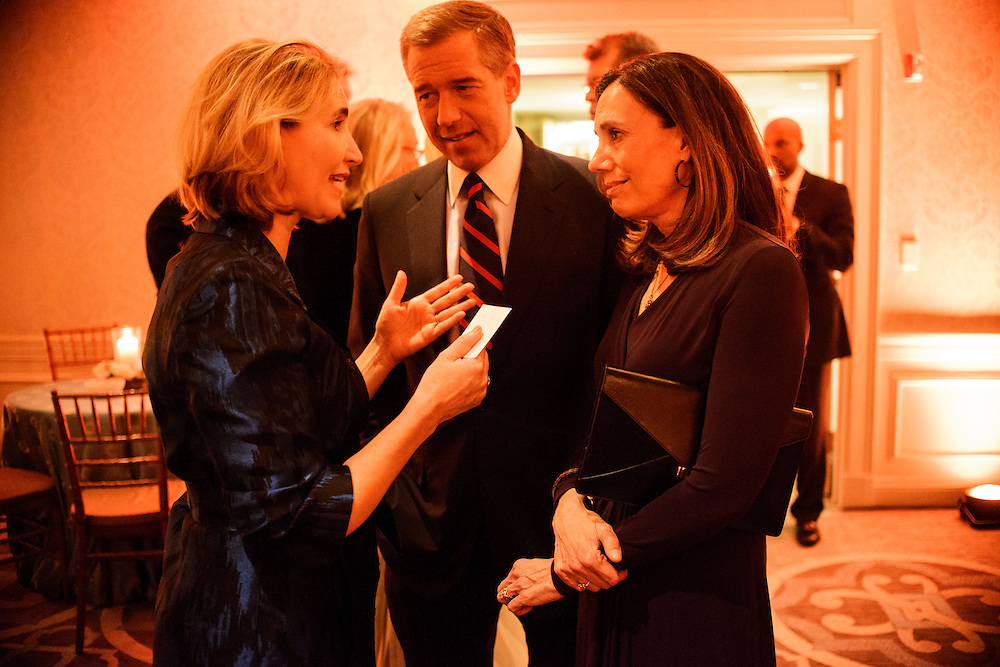 "Photo by Matt Roth.Assignment ID: 10137379A..Jackie Clegg Dodd talks with Brian Williams and wife Jane Williams during the Buffy and Bill Cafritz, Ann and Vernon Jordan, Vicki and Roger Sant inaugural ""Bi-Partisan Celebration"" at the Dolley Madison Ballroom at the Madison Hotel in Washington, D.C. on Monday, January 21, 2013."