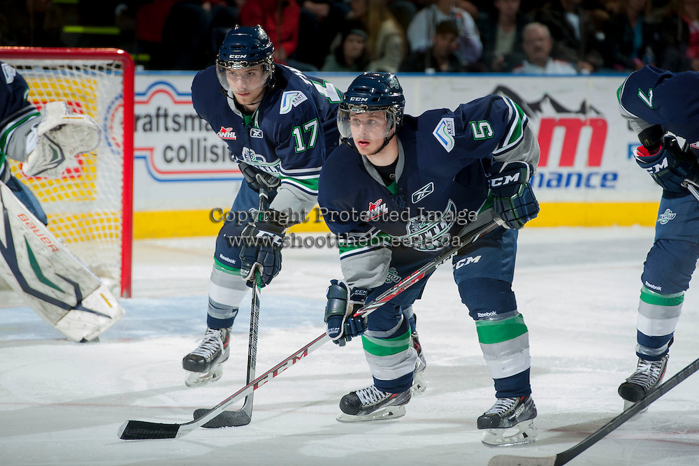 KELOWNA, CANADA - APRIL 5: Shea Theodore #17 and Sam McKechnie #5 of the Seattle Thunderbirds line up against the Kelowna Rockets on April 5, 2014 during Game 2 of the second round of WHL Playoffs at Prospera Place in Kelowna, British Columbia, Canada.   (Photo by Marissa Baecker/Getty Images)  *** Local Caption *** Shea Theodore; Sam McKechnie;