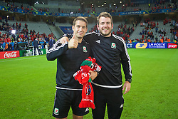 LILLE, FRANCE - Friday, July 1, 2016: Wales' sports science coach Adam Owen and Ronan Kavanagh after the 3-1 victory over Belgium during the UEFA Euro 2016 Championship Quarter-Final match at the Stade Pierre Mauroy. (Pic by David Rawcliffe/Propaganda)