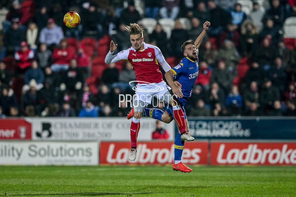 Danny Ward (Rotherham United) and Charlie Taylor (Leeds United) jump for a header during the EFL Sky Bet Championship match between Rotherham United and Leeds United at the New York Stadium, Rotherham, England on 26 November 2016. Photo by Mark P Doherty.
