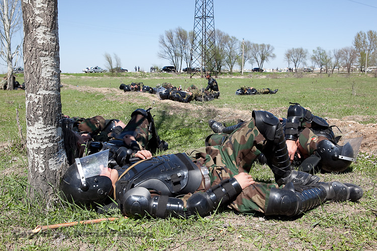 Riot police rest after restoring order following ethnic violence in Maevka that left at least five minority Mesketian Turks dead. April 20, 2010.