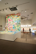 "The galleries of The American Folk Art Museum, with Jerry Gretzinger's ""Jerry's Map,"" in mulitple panels and cards."