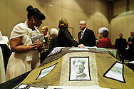 Darlene Ferman of St. Philip Neri Parish in Chicago examines a quilt crafted by parishioners at St. Peter Parish in Quincy, IL during a Gala Benefit Fundraiser for the Cause for Sainthood of Father Augustus Tolton at the Hyatt Regency McCormick Place in Chicago. The quilt depicts a timeline of Tolton's life crafted by current members of his former Parish. The priest was a slave born in Missouri in 1854 before joining the Catholic Church.  November 11, 2011 l Brian J. Morowczynski~ViaPhotos..For use in a single edition of Catholic New World Publications, Archdiocese of Chicago. Further use and/or distribution may be negotiated separately. ..Contact ViaPhotos at 708-602-0449 or email brian@viaphotos.com.