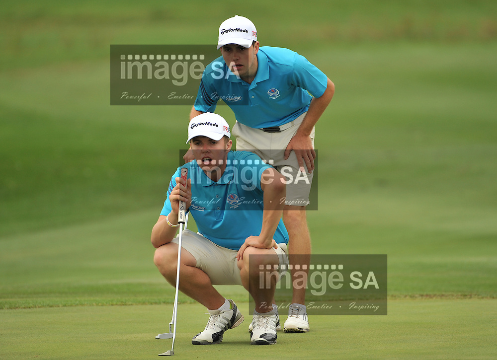 MALELANE, SOUTH AFRICA - Wednesday 18 February 2015, Greig Marchbank and Scott Gibson (standing) of Scotland, check the line on the 3rd green during the first round foursomes of the annual Leopard Trophy, a two day test between teams of the South African Golf Association and the Scottish Golf Union, at the Leopard Creek Golf Estate.<br /> Photo Roger Sedres/ Image SA