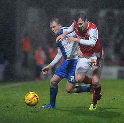 Bristol Rovers' David Clarkson is challenged by Morecambe's Tony Diagne - Photo mandatory by-line: Dougie Allward/JMP - Tel: Mobile: 07966 386802 14/12/2013 - SPORT - Football - Morecombe - Globe Arena - Morecombe v Bristol Rovers - Sky Bet League Two