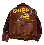 "This type A-2 flight jacket belonged to Joseph F. Doyle, a navigator attached to the 570th squadron of the 390th Bomb Group. Doyle flew 30 missions over Europe as a member of the 570th squadron. On the back of the jacket Doyle painted his crews logo; a German soldier running away from a barrage of bombs. The ""Skippy"" and her crew flew 30 missions before crashing on their 31st mission, a raid on an airfield in Villacoublay, France, on February 5, 1944. One of the engines on ""Skippy"" burst into flames just after getting into formation and crossing the English channel. The pilot turned the plane around, and the crew bailed out successfully over the channel as ""Skippy"" crash landed in England, about 100 yards from the channel."