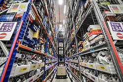 A high lift platform raises up so a worker can pick items to be shipped at Amazon's fulfillment centre in Swansea, in the run up to Black Friday.