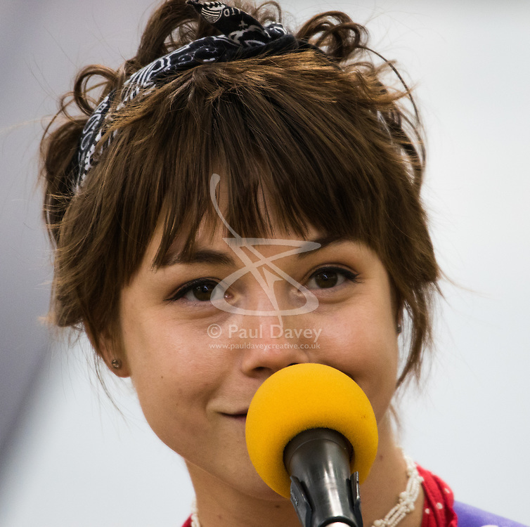 """London, July 18th 2015. Regular Southbank busker, singer/songwriter Emily Lee performs songs from her recently released EP """"Don't Forget To Love"""" in Leicester Square, during the Busk in London Festival, aimed at showcasing the outstanding talents of many of the capital's finest street performers, including, musicians, magicians, living statues and bands."""