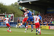 AFC Wimbledon defender Will Nightingale (5) battles for possession with Rotherham United goalkeeper Daniel Iverson (1) during the EFL Sky Bet League 1 match between AFC Wimbledon and Rotherham United at the Cherry Red Records Stadium, Kingston, England on 3 August 2019.