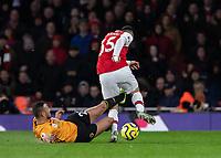Football - 2019 / 2020 Premier League - Arsenal vs. Wolverhampton Wanderers<br /> <br /> Romain Saiss (Wolverhampton Wanderers) fouls Gabriel Martinelli (Arsenal FC) to prevent him breaking away at The Emirates Stadium.<br /> <br /> COLORSPORT/DANIEL BEARHAM