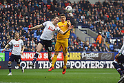 Preston North End Striker Jordan Hugill and Rob Holding battle during the Sky Bet Championship match between Bolton Wanderers and Preston North End at the Macron Stadium, Bolton, England on 12 March 2016. Photo by Pete Burns.