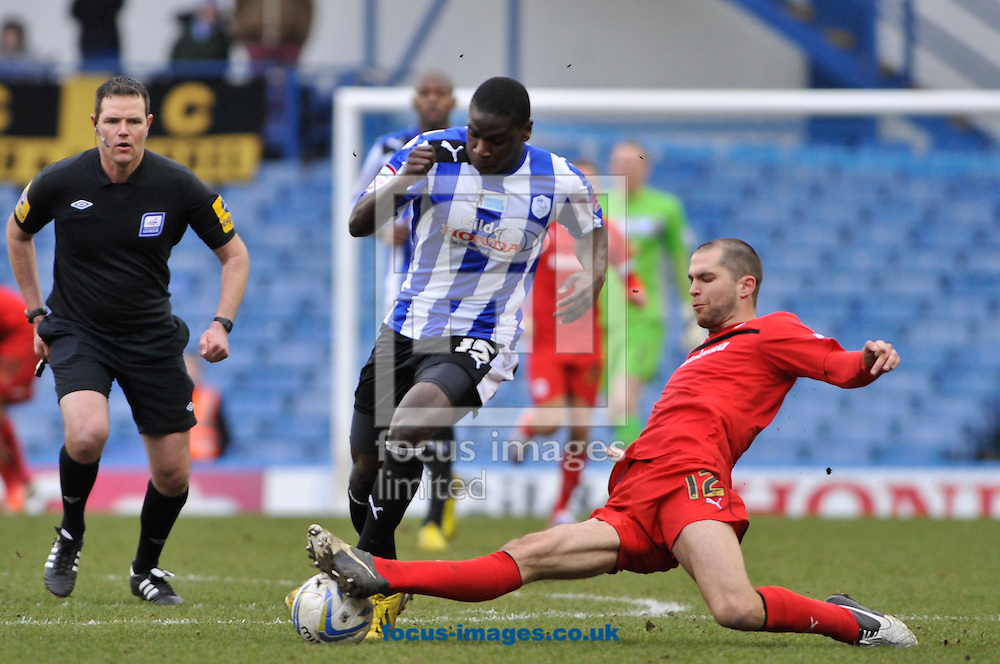 Picture by Richard Land/Focus Images Ltd +44 7713 507003.16/03/2013.Jeremy Helan of Sheffield Wednesday and Matthew Connolly of Cardiff City during the npower Championship match at Hillsborough, Sheffield.