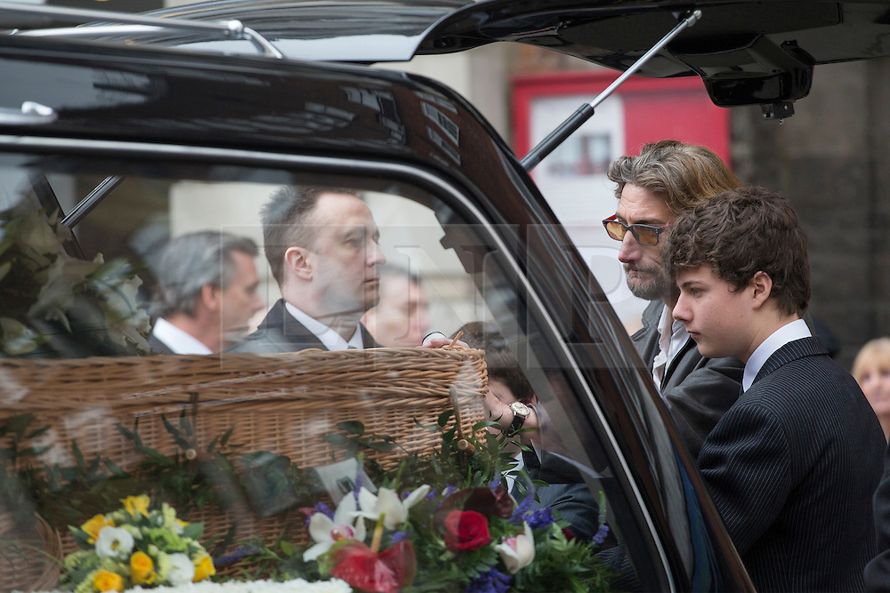 © licensed to London News Pictures. London, UK 20/03/2013. Nick Reynolds (second right) son of great train robber Bruce Reynolds, mourning at his father's funeral at St Bartholomew The Great in London. Photo credit: Tolga Akmen/LNP