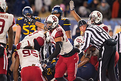 Nov 19, 2016; Morgantown, WV, USA; Oklahoma Sooners players celebrate after recovering a fumble during the second quarter against the West Virginia Mountaineers at Milan Puskar Stadium. Mandatory Credit: Ben Queen-USA TODAY Sports
