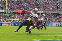 06 October 2013: Running back (23) Pierre Thomas of the New Orleans Saints runs the ball and scores a touchdown while being dragged down by (58) D.J. Williams of the Chicago Bears during the first half of the Saints 26-18 victory over the Bears in an NFL Game at Soldier Field in Chicago, IL.