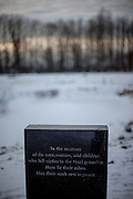 "Memorial stone at the  Auschwitz II/Birkenau camp where lies a pond with 4 gravestones with the inscription in 4 different languages: ""To the memory of the men, women, and children who fell victim to the Nazi genocide. In this pond lie their ashes.  May their souls rest in peace.""."