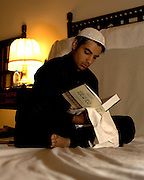 Opening batsman Salman Butt reading the Quran in the team's prayer room before the second test match between Pakistan and England in Faisalabad. Photo © Graham Morris (Tel: +44(0)20 8969 4192 Email: sales@cricketpix.com)