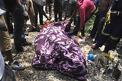 61087550<br /> The body of an illegal miner lies on the ground after being pulled out at an illegal gold mine in Benoni, outside Johannesburg, South Africa, Feb. 18, 2014. An illegal miner s body was discovered at an abandoned gold mine in Benoni where an accident happened a week ago, Tuesday, 18th February 2014. Picture by  imago / i-Images<br /> UK ONLY
