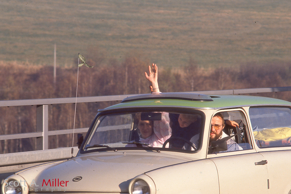 Cars load of people from East Germany are greeted as they cross the Intra-German border near Hof, West Germany on Nov. 10, 1989. The borders between East and West Germany had been opened Nov. 9, 1989 for the first time in nearly 40 years.<br /> <br /> &copy;Scott A. Miller
