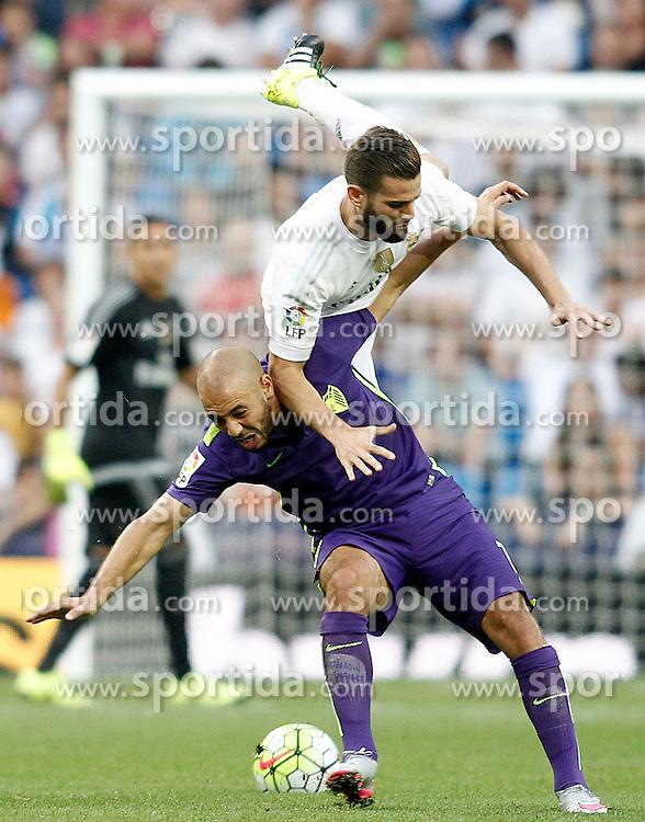 26.09.2015, Estadio Santiago Bernabeu, Madrid, ESP, Primera Division, Real Madrid vs Malaga CF, 6. Runde, im Bild Real Madrid's Nacho Fernandez (t) and Malaga's Nordim Amrabat // during the Spanish Primera Division 6th round match between Real Madrid and Malaga CF at the Estadio Santiago Bernabeu in Madrid, Spain on 2015/09/26. EXPA Pictures &copy; 2015, PhotoCredit: EXPA/ Alterphotos/ Acero<br /> <br /> *****ATTENTION - OUT of ESP, SUI*****