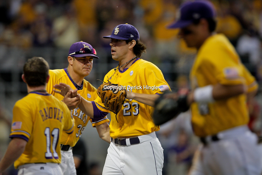 05 June 2009:  LSU pitcher Anthony Ranaudo (23) is congratulated by teammates as he runs off the field during game one of the NCAA baseball College World Series, Super Regional game between the Rice Owls and the LSU Tigers at Alex Box Stadium in Baton Rouge, Louisiana.