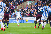 Jason Puncheon of Huddersfield Town (42) shoots during the Premier League match between Huddersfield Town and Arsenal at the John Smiths Stadium, Huddersfield, England on 9 February 2019.