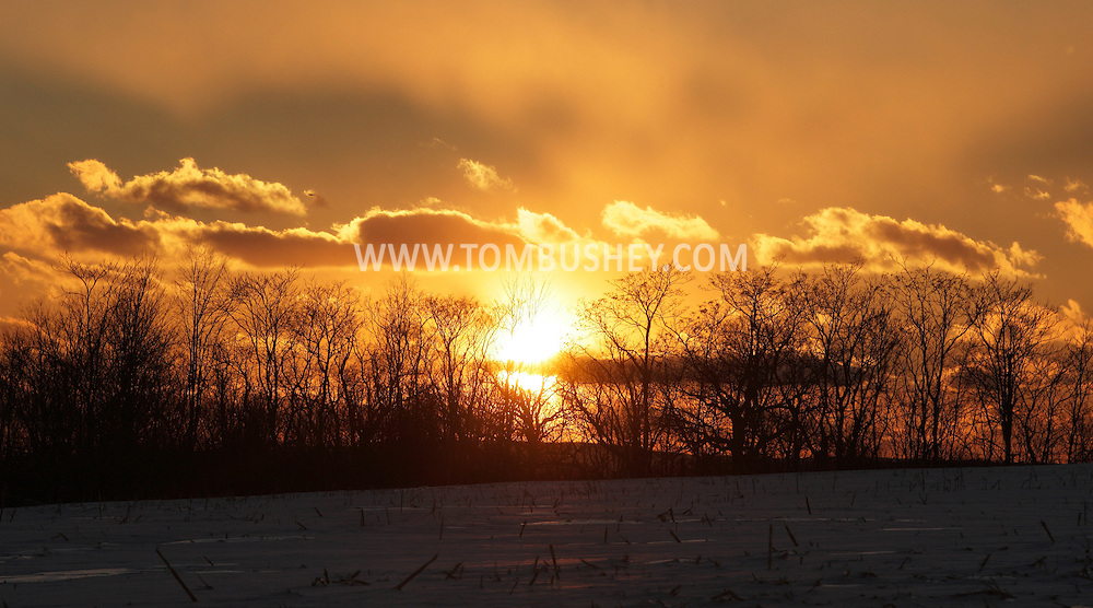 Middletown, New York - The sun sets behind clouds on Jan. 23, 2011.