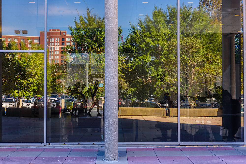 Reflections in the glass walls of the lobby of Hartford Hall on First Street on the Jefferson Community & Technical College downtown campus Thursday, Sept. 22, 2016 in Louisville, Ky. (Photo by Brian Bohannon)