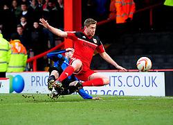 Barnsley's Martin Cranie tackles Bristol City's Steven Davies  - Photo mandatory by-line: Joe Meredith/JMP - Tel: Mobile: 07966 386802 23/02/2013 - SPORT - FOOTBALL - Ashton Gate - Bristol -  Bristol City V Barnsley - Npower Championship