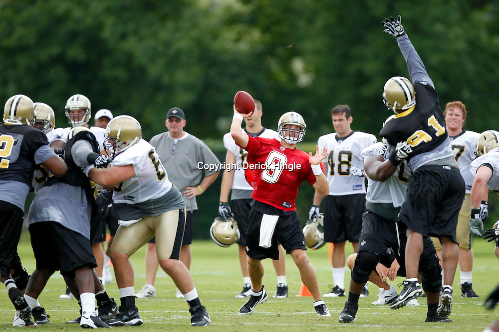 July 29, 2011; Metairie, LA, USA; New Orleans Saints quarterback Drew Brees (9) throws during a team drill on the first day of training camp at the New Orleans Saints practice facility. Mandatory Credit: Derick E. Hingle