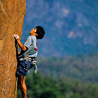 Tamotsu Sugino climbs the orange arete Mind the Bees, 5.13a, Ban Pak Ou, Luang Phrabang, Laos