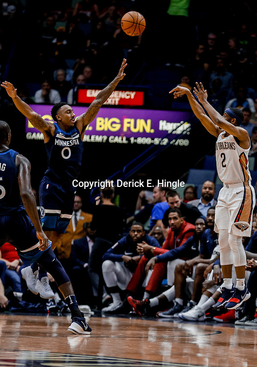 Nov 1, 2017; New Orleans, LA, USA; New Orleans Pelicans guard Ian Clark (2) shoots over Minnesota Timberwolves guard Jeff Teague (0) during the second quarter of a game at the Smoothie King Center. Mandatory Credit: Derick E. Hingle-USA TODAY Sports