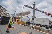 "The first finger is manouvered to be bolted on to its weighted plinth - The installation of Mexican artist Rivelino's 25-ton, 14.5 meter long sculpture You, in King Charles Island in Trafalgar Square. It is the first in a series of high-profile unveilings of contemporary Mexican sculpture across the capital this September, coinciding with the celebratory Dual Year of UK and Mexico 2015 (mexicouk2015.mx). In this case  ""two index fingers, equal in weight, colour and size point towards each other in commanding fashion. Intended as a reflection on human equality, the two pointing fingers are seen from afar as distinct entities; but through engaging in the intervening space between the fingers, the viewer opens up a dialogue of inclusivity. """