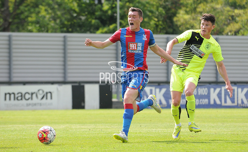 Connor Dymond screams out in pain as he's clipped going forward during the U21 Professional Development League match between Crystal Palace U21s and Huddersfield U21s at Imperial Fields, Tooting, United Kingdom on 7 September 2015. Photo by Michael Hulf.