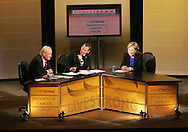27 August 2007: MSNBC Hardball host Chris Matthews (left), and Lance Armstrong (center), listen to Democratic presidential hopeful Senator Hillary Clinton (D-NY) (right) answer a question at the LIVESTRONG Presidential Cancer Forum in Cedar Rapids, Iowa on August 27, 2007.