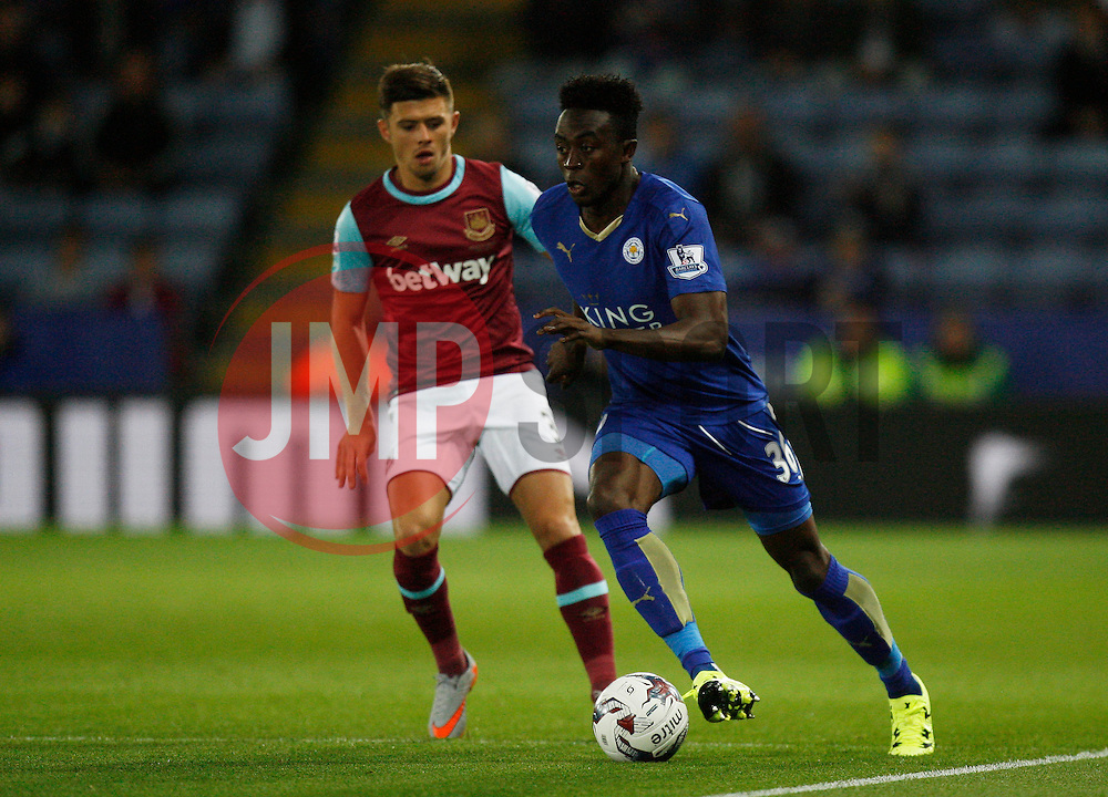 Joe Dodoo of Leicester City and Aaron Cresswell (L) of West Ham United in action  - Mandatory byline: Jack Phillips/JMP - 07966386802 - 22/09/2015 - SPORT - FOOTBALL - Leicester - King Power Stadium - Leicester City v West Ham United - Capital One Cup Round 3
