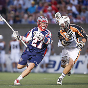 Kevin Buchanan #27 of the Boston Cannons keeps the ball away from Mike Manley #5 of the Rochester Rattlers during the game at Harvard Stadium on August 9, 2014 in Boston, Massachusetts. (Photo by Elan Kawesch)