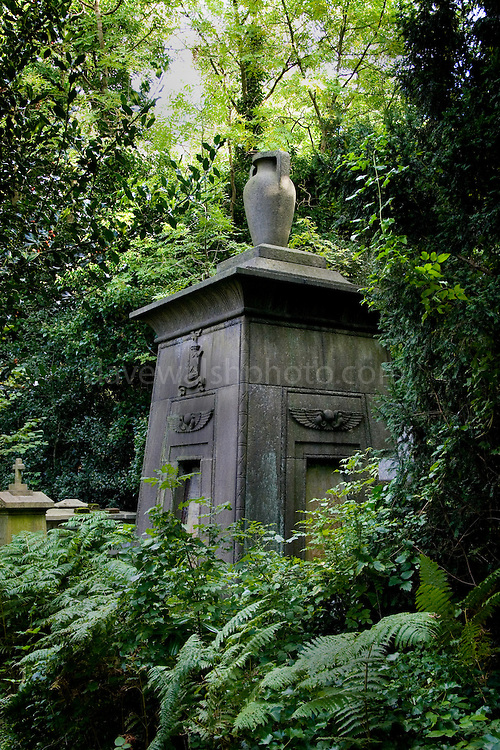 Tomb, Highgate Cemetery London, completely overgrown and abandoned