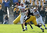 18 OCTOBER 2008: Wisconsin quarterback Dustin Sherer (18) throws a pass over Iowa defensive lineman Matt Kroul (53) in the first half of an NCAA college football game against Wisconsin, at Kinnick Stadium in Iowa City, Iowa on Saturday Oct. 18, 2008. Iowa won 38-16.