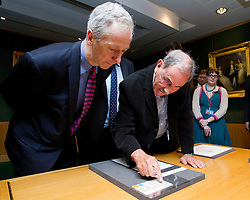 "© Licensed to London News Pictures. 22/05/2013. London, UK. Hunter Davies, the acclaimed Beatles biographer and Roly Keating, the chief executive of the British Library, look at a postcard sent to Hunter and his wife by John and Cynthia Lennon in 1968 at the British Library in London today (22/05/2013). The postcard is part of manuscripts and lyrics donated to the library under the ""lifetime giving"" scheme. Photo credit: Matt Cetti-Roberts/LNP"