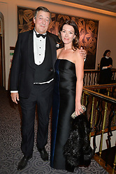 STEPHEN FRY and actress JUSTINE WADDELL at the Gift of Life Gala Ball celebrating the Russian Old new Year's Eve in aid of the Gift of Life foundation held at The Savoy, London on 13th January 2015.
