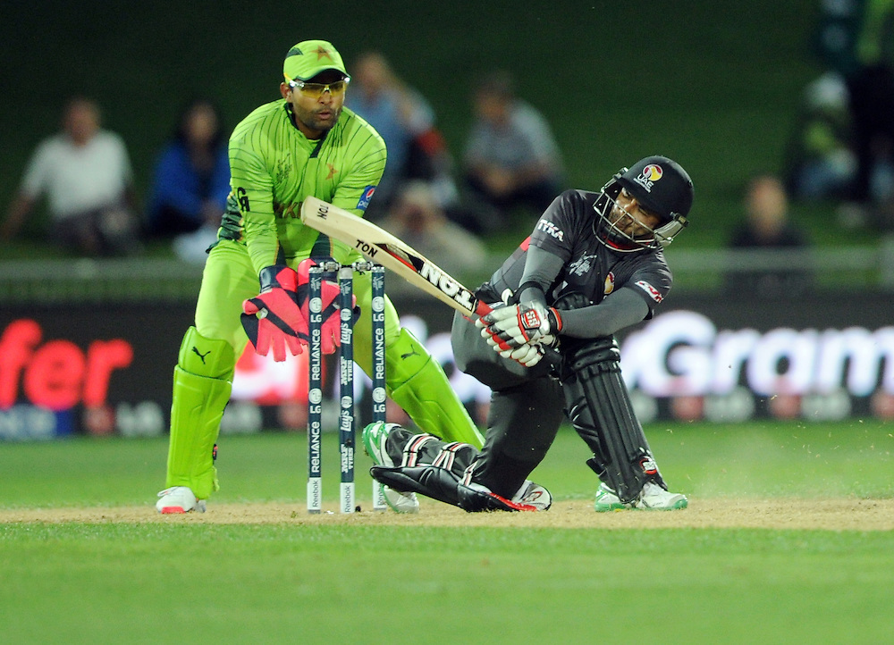 United Arab Emirates' Khurram Khan hits out to be caught off the bowling of Pakistan's Sohaib Maqsood for 43 in the ICC Cricket World Cup at McLean Park, Napier, New Zealand, Wednesday, March 04, 2015. Credit:SNPA / Ross Setford