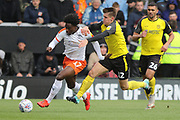 Luton Town midfielder Pelly Ruddock on the ball as Burton Albion midfielder Ben Fox challenges during the EFL Sky Bet League 1 match between Burton Albion and Luton Town at the Pirelli Stadium, Burton upon Trent, England on 27 April 2019.